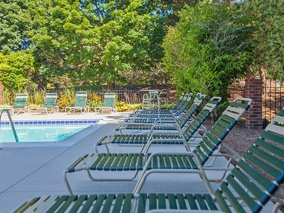 There's plenty of room to relax at the pool area at Fairlane Meadow Apartments.