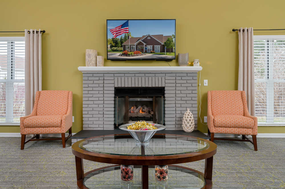 Clinton Place Apartments warm lounge with fireplace in Clinton Township, MI