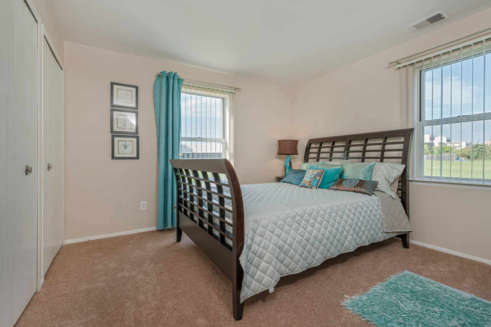 Well decorated bedroom at Clinton Place Apartments in Clinton Township, MI