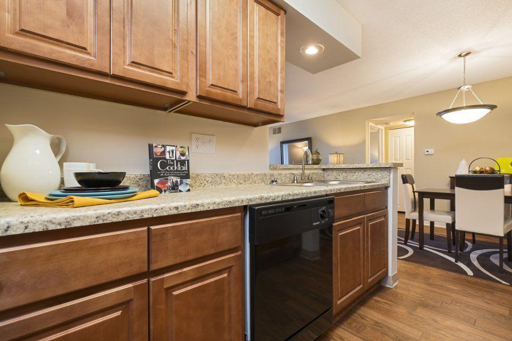 Kitchen at Hamptons of Cloverlane Apartments in Ypsilanti, MI