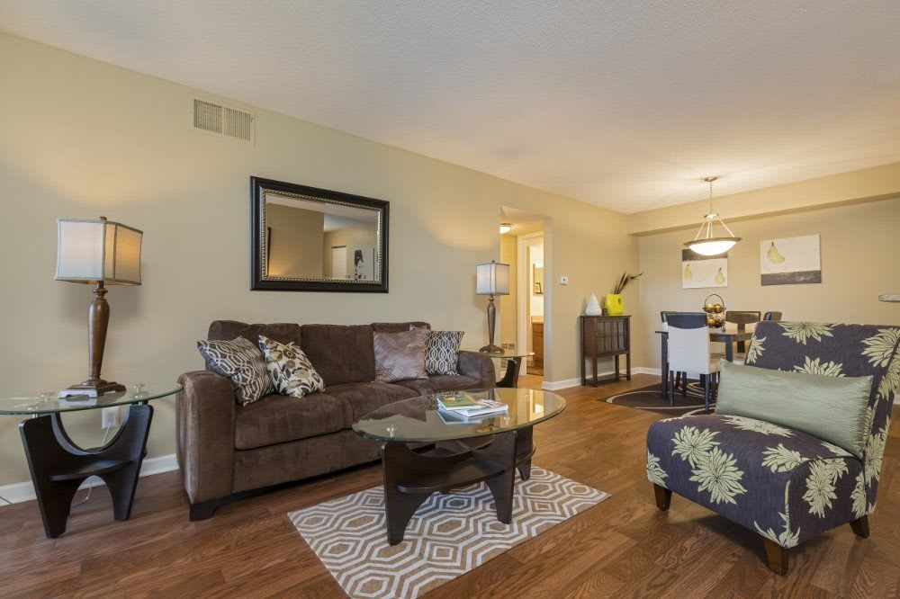 Living room at Hamptons of Cloverlane Apartments in Ypsilanti, MI