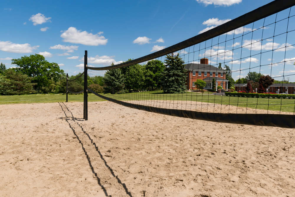 Volleyball court at Independence Green Apartments in Farmington Hills, MI