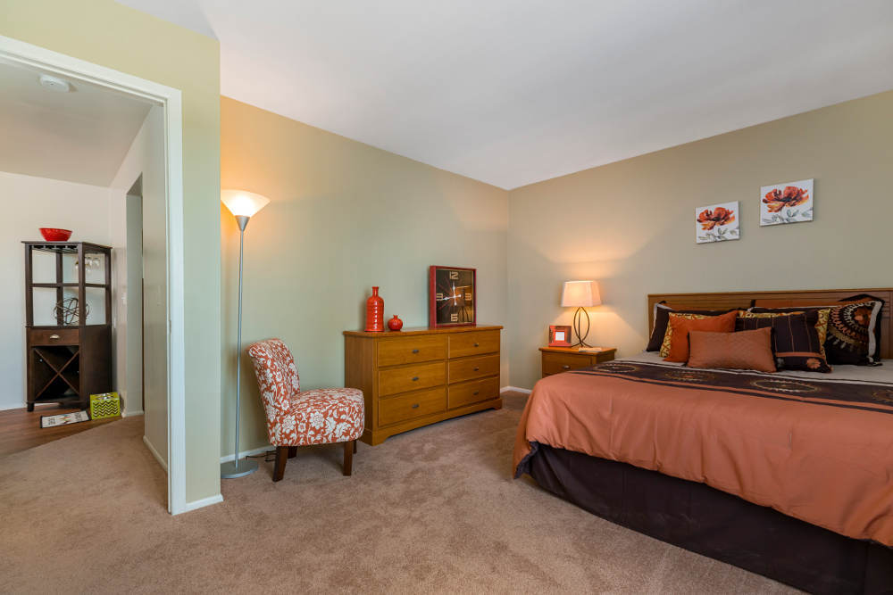 Well decorated bedroom at Independence Green Apartments in Farmington Hills, MI