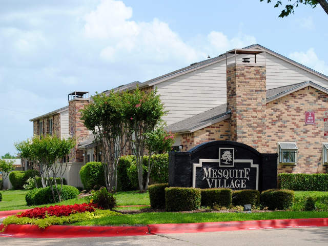 Welcome sign at Mesquite Village Apartments in Texas