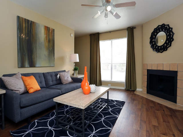 Living room and fireplace at Mesquite Village Apartments in Mesquite, TX