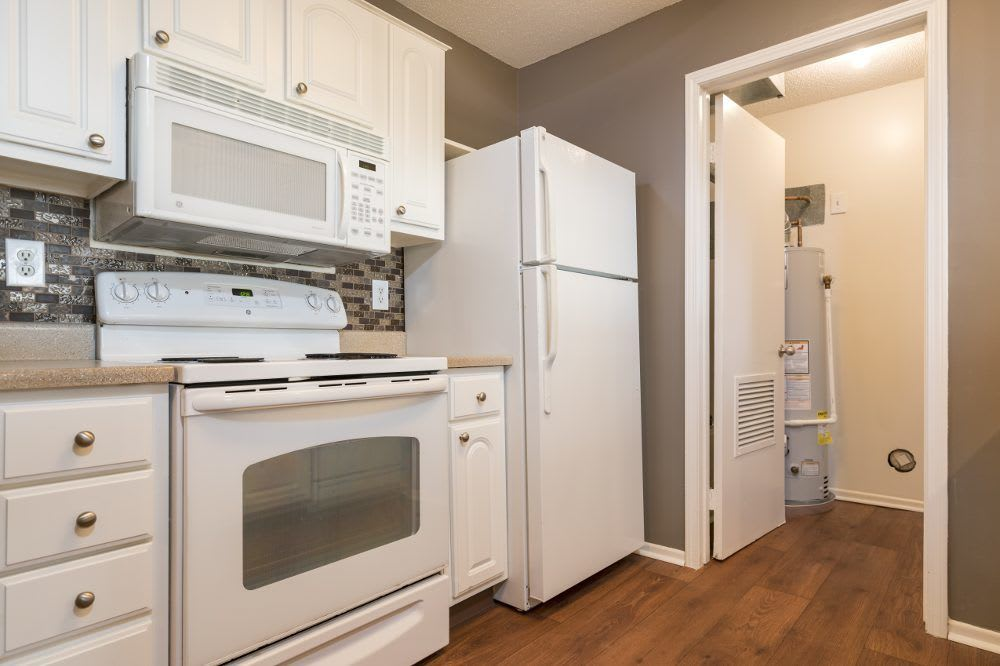Kitchen with appliances at Sturbridge Square Apartments