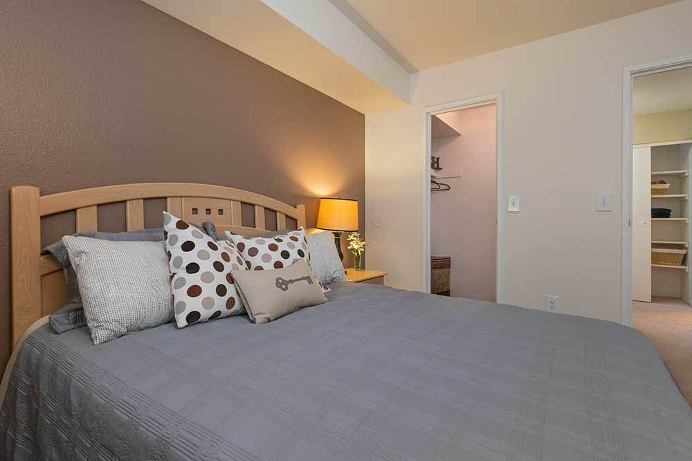 The Pines of Cloverlane Apartments has comfy looking bedrooms.