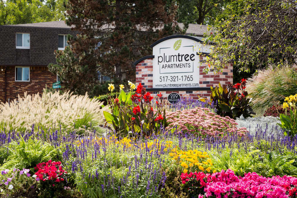 Welcome sign at Plumtree Apartments in Lansing, MI