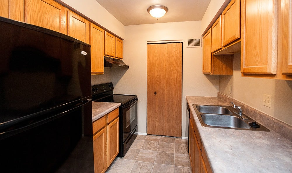 Another view of the kitchen of an apartment at The Woodlands Apartments in Toledo, OH