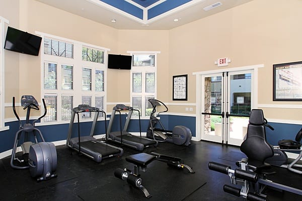Enjoy apartment amenities including a gym at The Lodge at Napa Junction