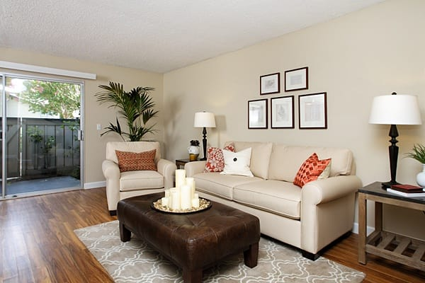 Gorgeous living room with cozy couches at Del Prado