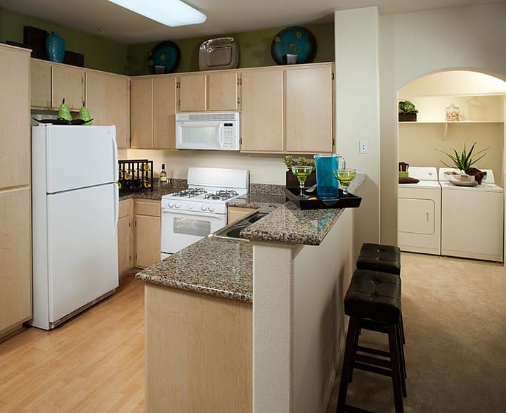 Kitchen and dining area view of an empty luxury apartment at Waterford Place Apartments