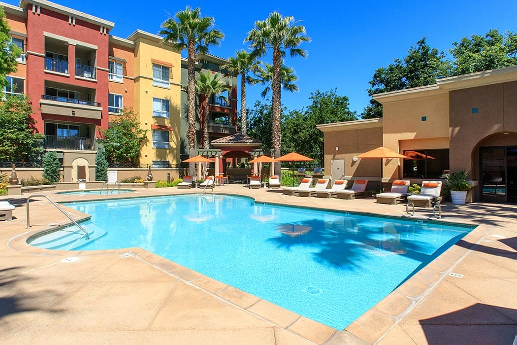The Waterford Place Apartments pool area is a popular spot to meet with friends and neighbors