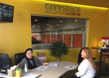 Main office with customer and front desk woman at CitySpace on Mellwood Self Storage