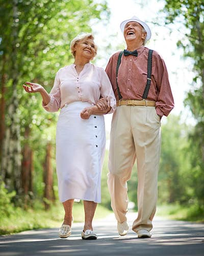 Couple enjoy a walk at Waverly Inn