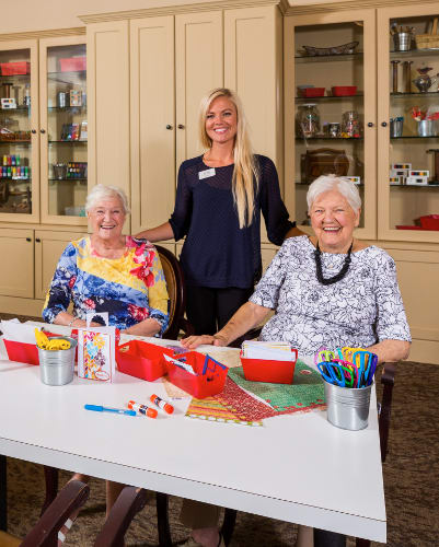 Staff helping residents with crafts at Waverly Inn