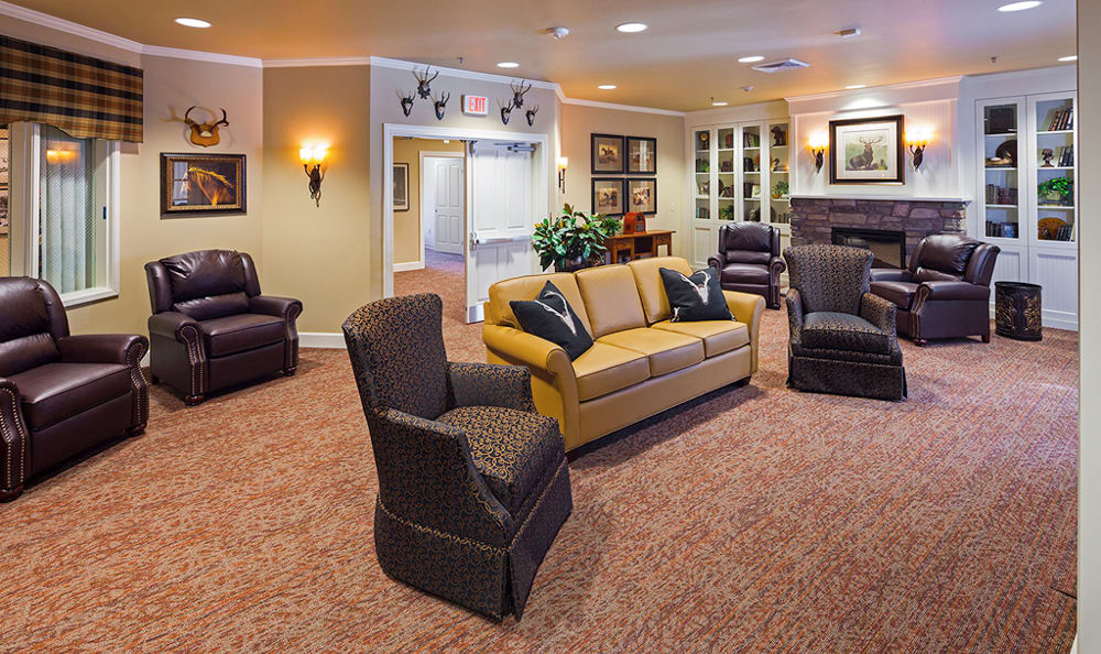 The senior living facility in Vancouver, WA, has cozy seating by the fireplace.