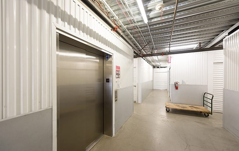 Elevator and hall at storage facility in Lakewood, CA.