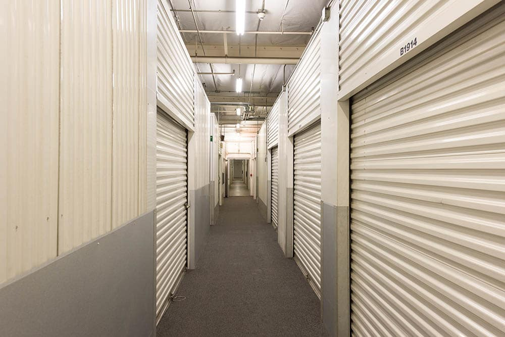 Lit hallway at self storage facility in Pasadena, CA.