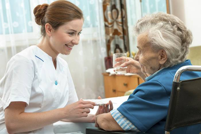 Nurse taking care of resident at The Terraces at Park Marino