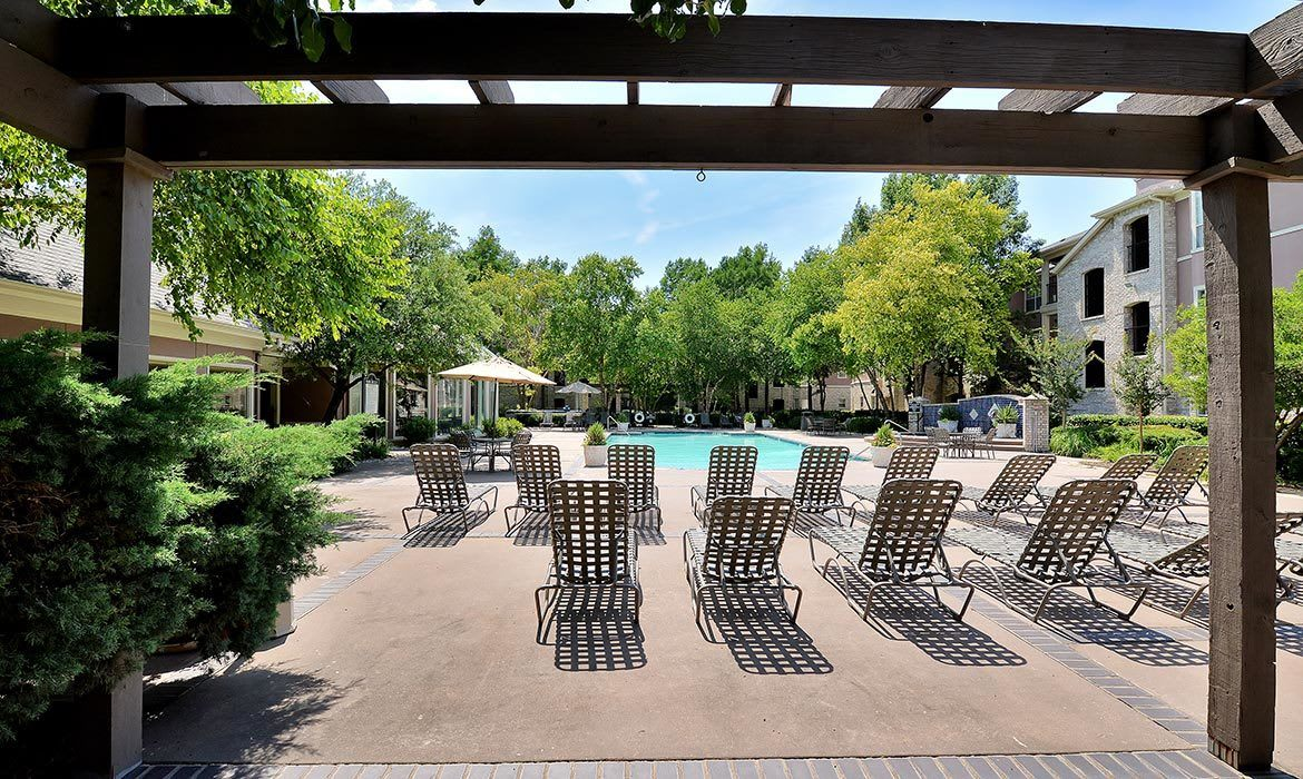 The pool area at Bentley Place at Willow Bend includes an expansive sun deck and plenty of lounge chair seating for all.