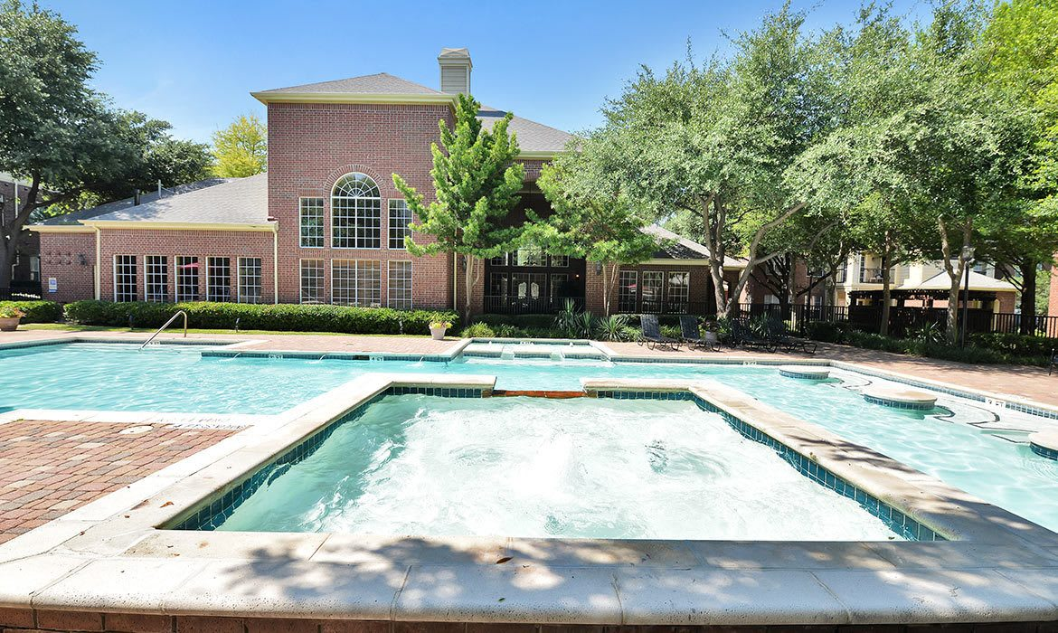 Our sparkling swimming pool area at Gates de Provence beckons on warm days here in Dallas, TX.