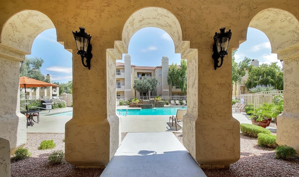 The pool area at Ventana Apartment Homes includes an expansive sun deck and plenty of lounge chair seating for all.
