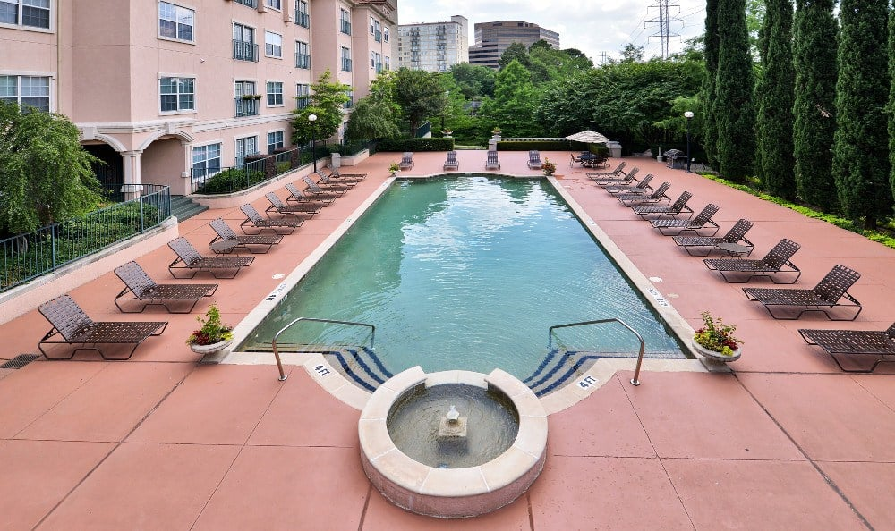 The pool area at The Villas at Katy Trail in Uptown includes an expansive sun deck and plenty of lounge chair seating for all.