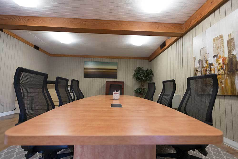 The conference room is nice and private for new lease signings and chats at StorageMax Northtown!
