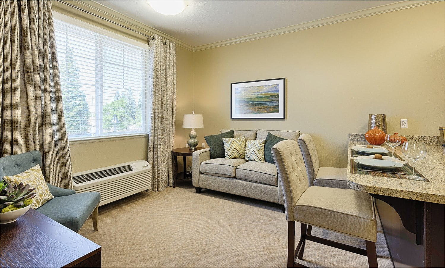 Living room with dining table at Kingston Bay Senior Living in Fresno, California.