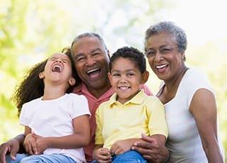 Happy family enjoying the sunshine at the senior living in York