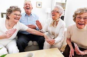 Friends enjoying cards at the senior living community in Salt Lake City