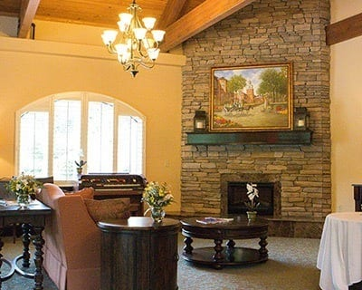 Senior living in New Port Richey has a common fireplace for everyone to enjoy