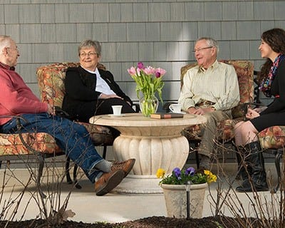 Residents relaxing on the front porch at the senior living in Bala Cynwyd