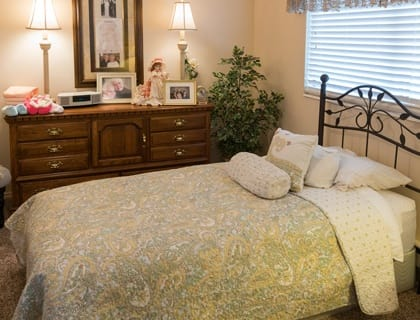 Comfortable bedroom at senior living in Saint George.