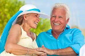 Happy couple enjoying the sunshine at the senior living community in Sandy