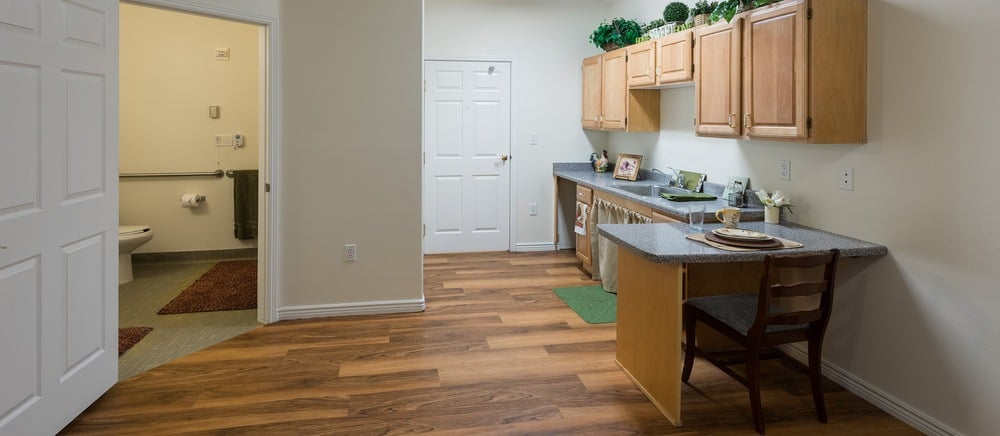 Sandy senior living includes cozy kitchens.