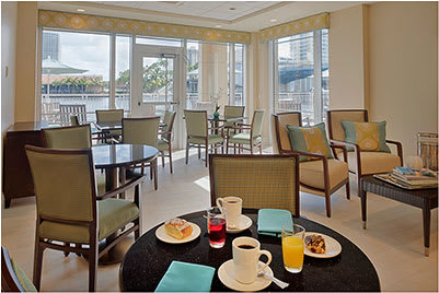 Enjoy a bite to eat with friends at Symphony at the Waterways Memory Care