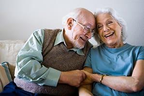 Happy senior couple in Cadillac