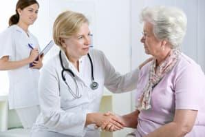 A nurse checks-up on a resident senior living facility in Cadillac