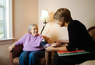 Resident getting a checkup by a doctor at the senior living community in Calumet