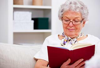 Resident reading at Gardenview in Calumet