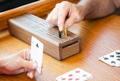 Playing cribbage at Lakewood Memory Care in Lakewood.