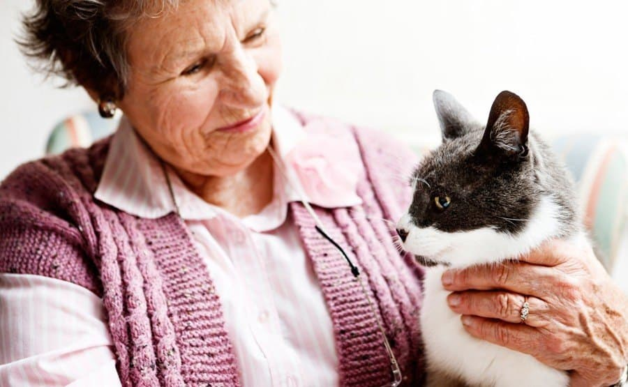 Resident with cat at Lighthouse Memory Care in Anacortes
