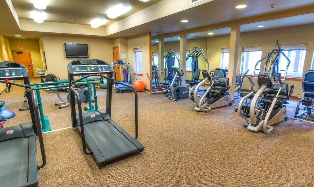 Large Coral Club Fitness at The Quarry Senior Living in Vancouver.