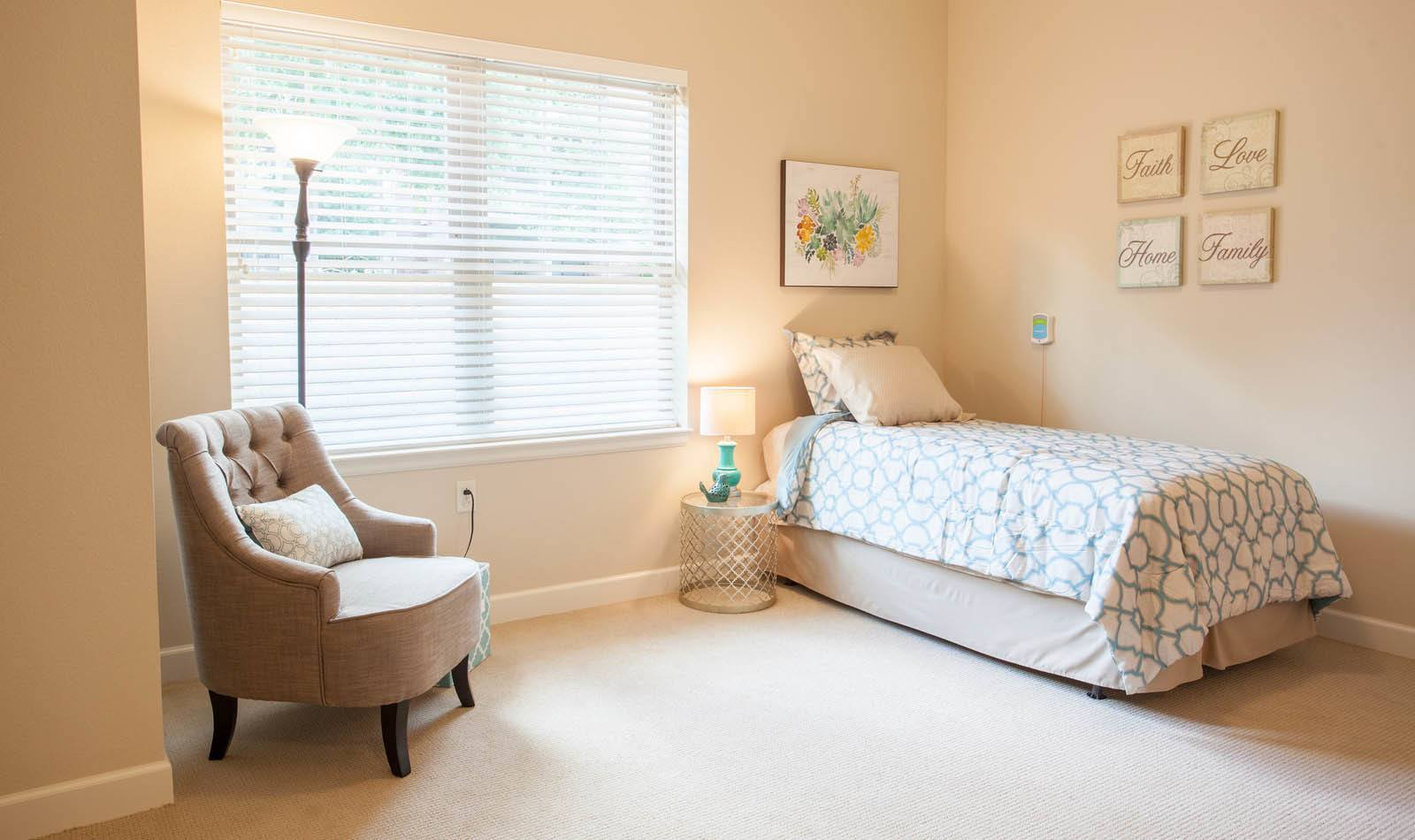 Great bedroom at Lakewood Memory Care in Lakewood