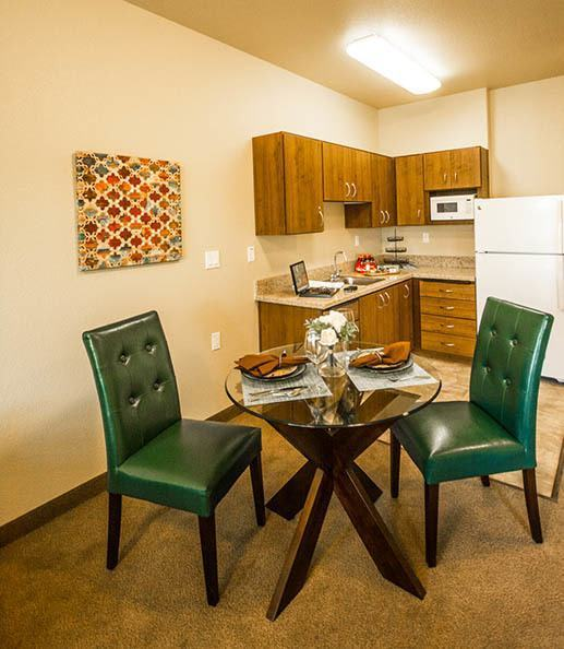 Kitchen and table in Almond Heights Senior Living unit