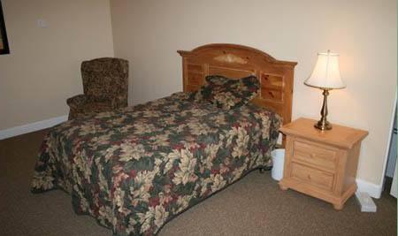 Comfortable bedroom at Arbor Rose Senior Care