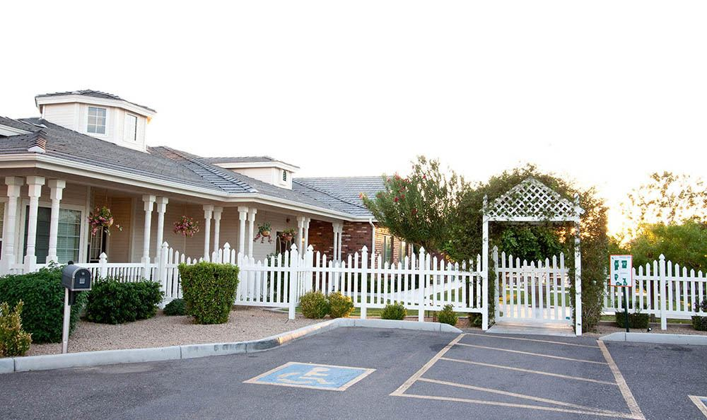 White picket fence at Arbor Rose Senior Care