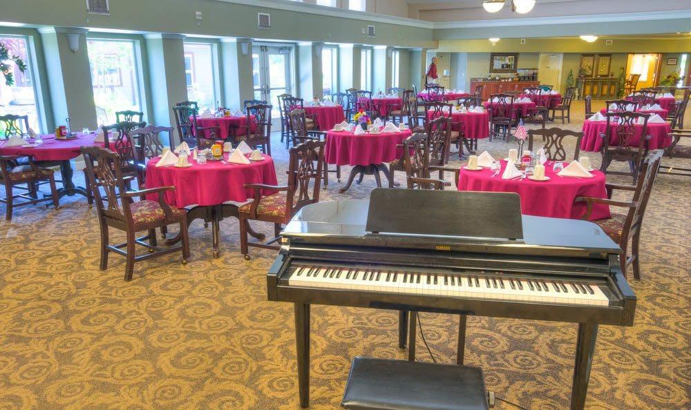 Spacious Dining Hall with Piano At Eagle Lake Village Senior Living in Susanville.